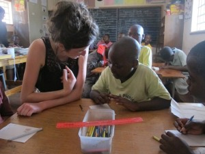Assisting in Mavambo Learning Centre in Zimbabwe. The centre comprises 3 classrooms and teaches Maths, English and Shona to children, regardless of their age, who have never been to school before