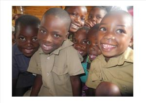 Children at a school in Zimbabwe. CAFOD provides resources for the school and pays the school fees for children who would otherwise be out of school.