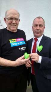 CAFOD volunteer, Phil Mayland meeting local MP, Paul Ferrelly and giving him a green heart