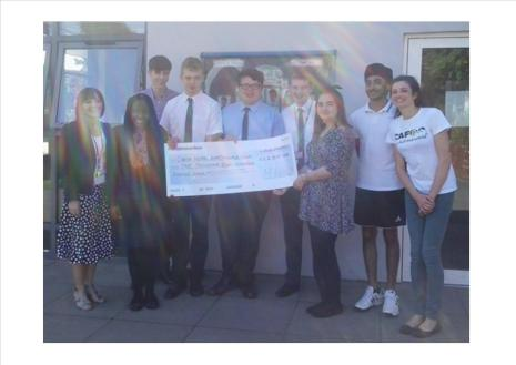 Students from Cardinal Newman in Coventry presenting a cheque to CAFOD