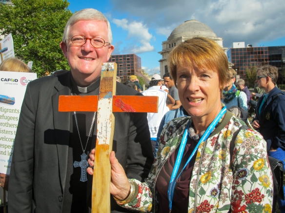The Archbishop and Dame Caroline after addressing the group - with a Lampedusa cross